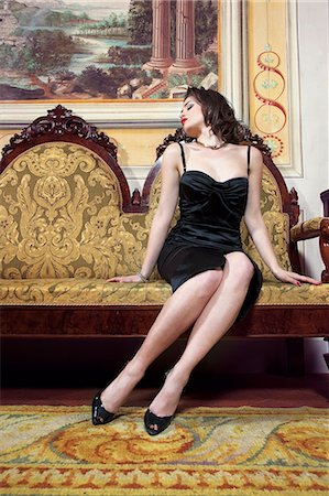 sexi women full body - Woman in lingerie on ornate couch Stock Photo - Premium Royalty-Free, Code: 649-06533245