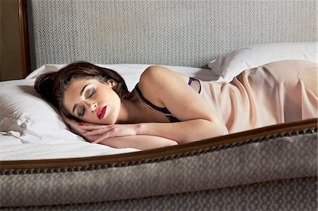 sexy - Woman in lingerie sleeping in bed Stock Photo - Premium Royalty-Free, Code: 649-06533269