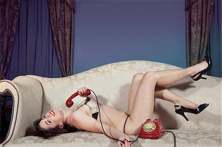seductive - Woman in lingerie holding phone Stock Photo - Premium Royalty-Free, Code: 649-06533261