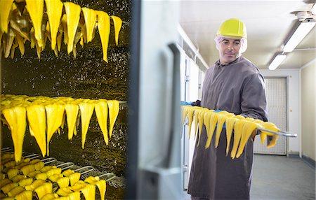 smoked - Worker smoking haddock filets in factory Stock Photo - Premium Royalty-Free, Code: 649-06533401