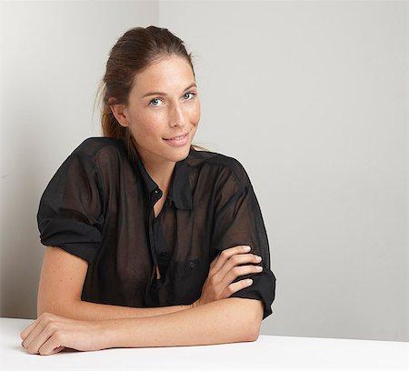 portrait smile caucasian one - Smiling woman sitting at desk Stock Photo - Premium Royalty-Free, Code: 649-06533465