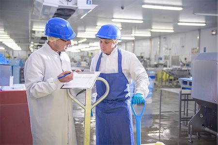 food processing plant - Workers talking in factory Stock Photo - Premium Royalty-Free, Code: 649-06533462