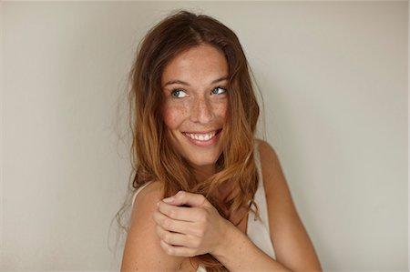 portrait smile caucasian one - Smiling woman sitting indoors Stock Photo - Premium Royalty-Free, Code: 649-06533501