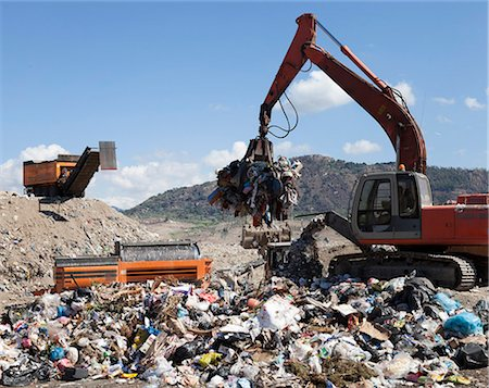 Machinery grabbing waste in landfill Stock Photo - Premium Royalty-Free, Code: 649-06533601