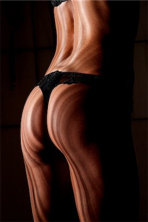 Shadows reflecting on womans back Stock Photo - Premium Royalty-Free, Code: 649-06621938