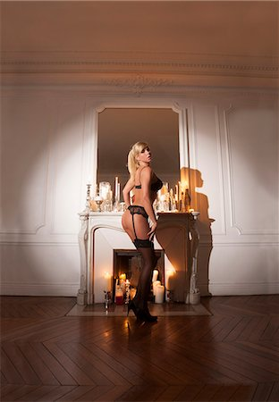 Woman in lingerie by candles Stock Photo - Premium Royalty-Free, Code: 649-06621933