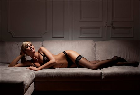sexi women full body - Woman in lingerie laying on sofa Stock Photo - Premium Royalty-Free, Code: 649-06621946