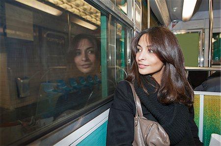Smiling woman riding subway Stock Photo - Premium Royalty-Free, Code: 649-06621969