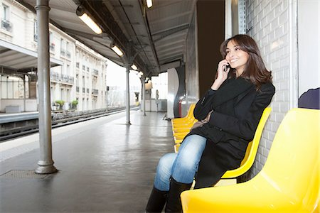 platform - Woman on cell phone at train station Stock Photo - Premium Royalty-Free, Code: 649-06621971