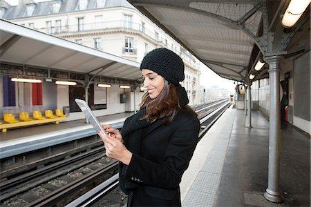 Woman using tablet computer on platform Stock Photo - Premium Royalty-Free, Code: 649-06621973