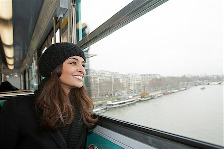 Smiling woman riding train over water Stock Photo - Premium Royalty-Free, Code: 649-06621987