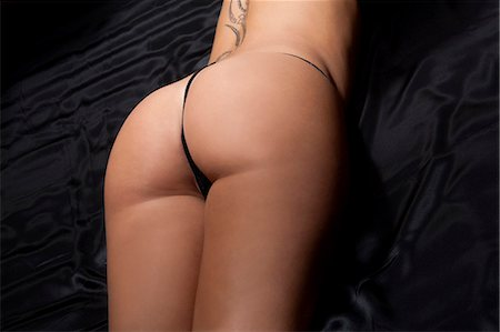 Close up of nude womans buttocks Stock Photo - Premium Royalty-Free, Code: 649-06622034