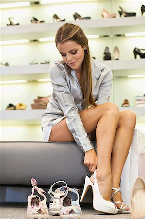 Woman trying on shoes in store Stock Photo - Premium Royalty-Free, Code: 649-06622181