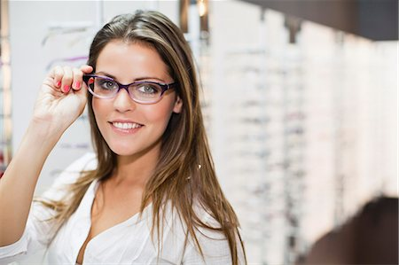 portrait smile caucasian one - Woman trying on glasses in store Stock Photo - Premium Royalty-Free, Code: 649-06622203