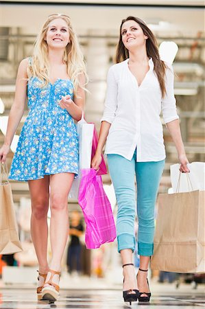Women shopping together in mall Stock Photo - Premium Royalty-Free, Code: 649-06622218