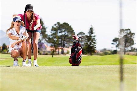 Women playing golf on course Stock Photo - Premium Royalty-Free, Code: 649-06622228