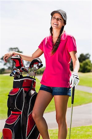 Woman holding golf bag on course Stock Photo - Premium Royalty-Free, Code: 649-06622229