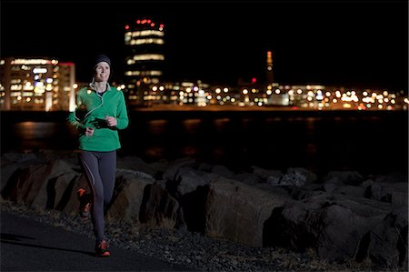 Woman running on waterfront at night Stock Photo - Premium Royalty-Free, Code: 649-06622244