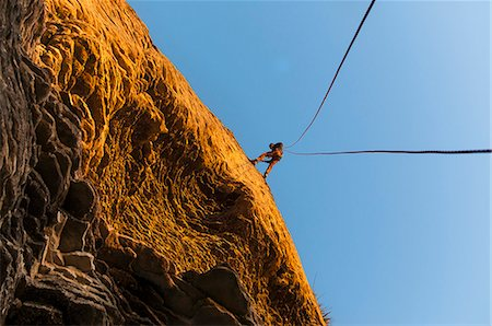 rock climber - Rock climber scaling steep rock face Stock Photo - Premium Royalty-Free, Code: 649-06622366