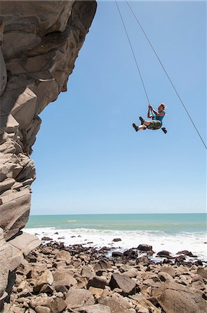 swing (sports) - Rock climber abseiling jagged cliff Stock Photo - Premium Royalty-Free, Code: 649-06622375