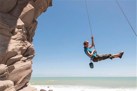 swing (sports) - Rock climber abseiling jagged cliff Stock Photo - Premium Royalty-Free, Code: 649-06622376