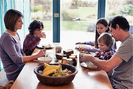 family table eating together - Family having dinner together at table Stock Photo - Premium Royalty-Free, Code: 649-06622410