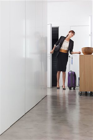 Woman returning from business trip Stock Photo - Premium Royalty-Free, Code: 649-06622507