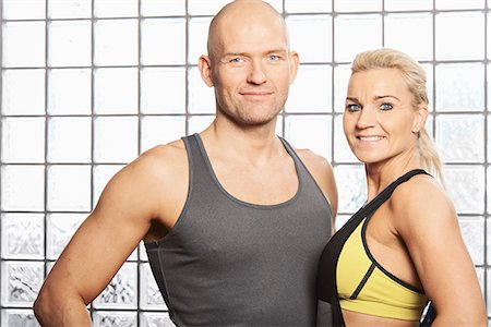 Couple smiling together in gym Stock Photo - Premium Royalty-Free, Code: 649-06622500