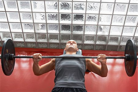 Man lifting weights in gym Stock Photo - Premium Royalty-Free, Code: 649-06622503