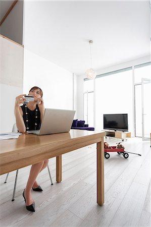 Businesswoman shopping online Stock Photo - Premium Royalty-Free, Code: 649-06622527