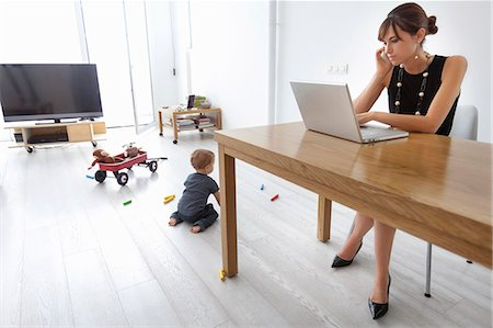 Businesswoman working at home Stock Photo - Premium Royalty-Free, Code: 649-06622529