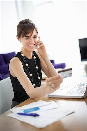 person on phone with credit card - Businesswoman shopping on phone Stock Photo - Premium Royalty-Free, Code: 649-06622521