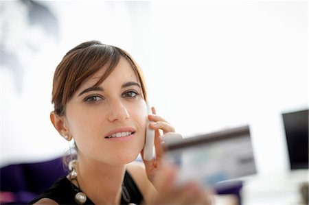 person on phone with credit card - Businesswoman shopping on phone Stock Photo - Premium Royalty-Free, Code: 649-06622522