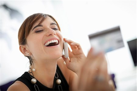 person on phone with credit card - Businesswoman shopping on phone Stock Photo - Premium Royalty-Free, Code: 649-06622523