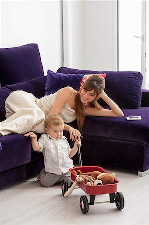 pushing - Mother and son relaxing in living room Stock Photo - Premium Royalty-Free, Code: 649-06622542