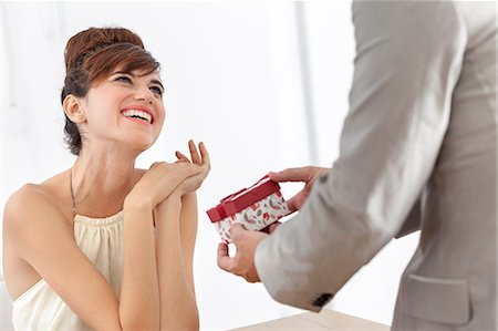Man giving smiling girlfriend present Stock Photo - Premium Royalty-Free, Code: 649-06622568