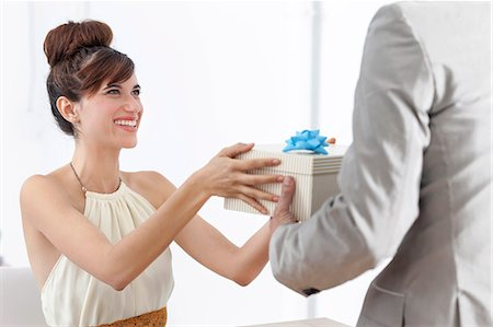 Man giving smiling girlfriend present Stock Photo - Premium Royalty-Free, Code: 649-06622569
