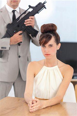 dominant woman - Woman and boyfriend with machine gun Stock Photo - Premium Royalty-Free, Code: 649-06622581