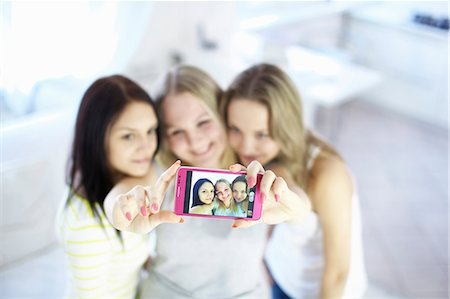 Teenage girls taking picture together Stock Photo - Premium Royalty-Free, Code: 649-06622657