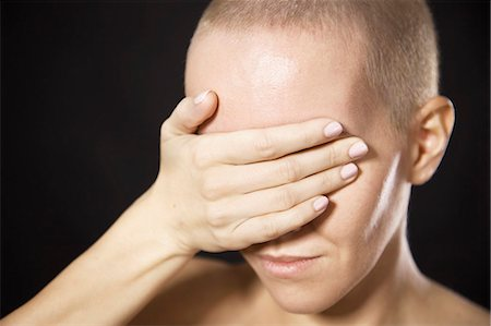 Nude woman covering her eyes Stock Photo - Premium Royalty-Free, Code: 649-06622683