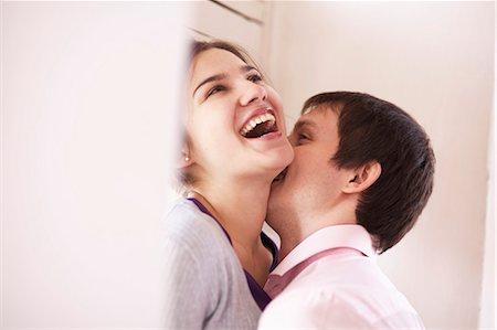 Man kissing girlfriend indoors Stock Photo - Premium Royalty-Free, Code: 649-06622701