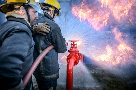 student fighting - Firefighters in simulation training Stock Photo - Premium Royalty-Free, Code: 649-06622757