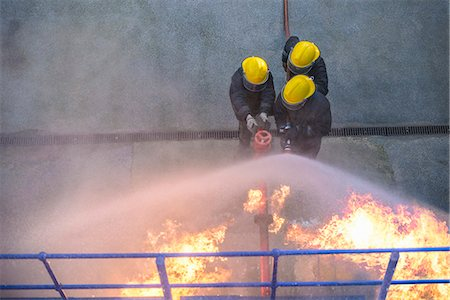 student fighting - Firefighters in simulation training Stock Photo - Premium Royalty-Free, Code: 649-06622758