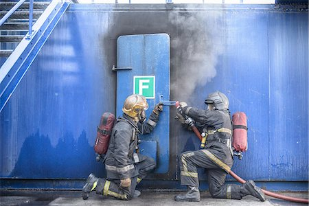 student fighting - Firefighters in simulation training Stock Photo - Premium Royalty-Free, Code: 649-06622764