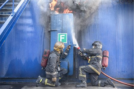 student fighting - Firefighters in simulation training Stock Photo - Premium Royalty-Free, Code: 649-06622765