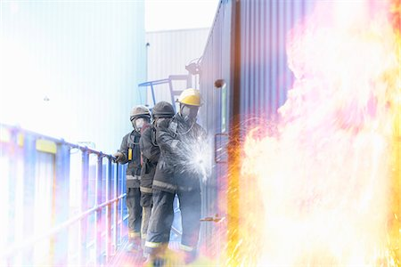 Firefighters in simulation training Stock Photo - Premium Royalty-Free, Code: 649-06622766