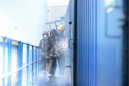 Firefighters in simulation training Stock Photo - Premium Royalty-Free, Code: 649-06622767