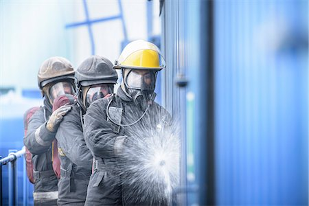 Firefighters in simulation training Stock Photo - Premium Royalty-Free, Code: 649-06622768