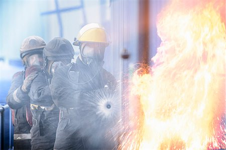Firefighters in simulation training Stock Photo - Premium Royalty-Free, Code: 649-06622769