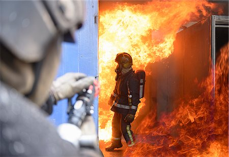 student fighting - Firefighters in simulation training Stock Photo - Premium Royalty-Free, Code: 649-06622762